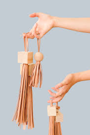 how to make diy statement tassels with wood blocks and leather through for the