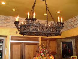 wrought iron lighting fixtures kitchen. kitchen using wrought iron chandelier with pot and pans hooks lighting fixtures l