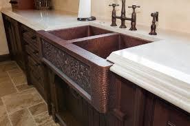 vine design on copper sink