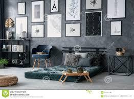 Futon Interior Design Blue Armchair Next To Green Futon In Bedroom Interior With