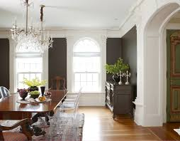 traditional dark oak furniture. splashy lucite chair in dining room traditional with dark carpeting next to light walls furniture oak