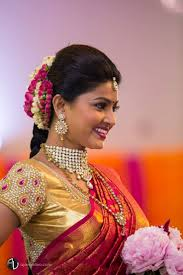 traditional southern indian bride wearing bridal saree jewellery and hairstyle bridalmakeup