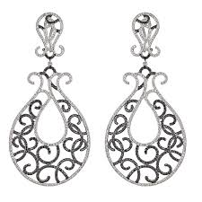 white gold chandelier earrings with black and white diamonds
