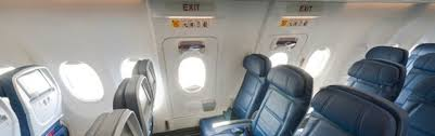 main cabin seats in the emergency exit rows inside a boeing 737 900er 739