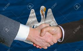 Two Businessmen Shaking Hands After Good Business Investment.. Stock ...