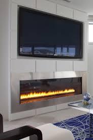 hdtv above a sleek fireplace montigo fireplace