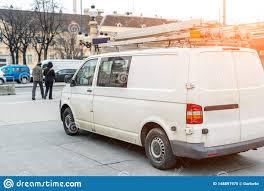 Van Light Bars White Repair And Service Van With Ladder And Orange Light
