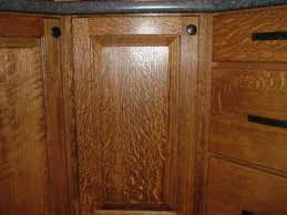 I Think Either The White Or Red Oak Will Work Well. Just A Little Stain  Brings Out The Grain Patterns. Here Are Some Quarter Sawn Red Oak Cabinets.
