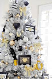 View in gallery Stunning white Christmas tree with gold, black, and white  decorations