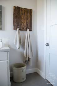 Traditional Diy Bathroom Remodel With 2 Towels In Wood Towel Holders And  White Wood Door White Painted Wall Above Wood Floor Tips on DIY Bathroom  Remodel ...