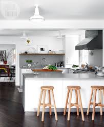 image modern kitchen. A Continuous Caesarstone Countertop Replaced An Awkward Peninsula In The Open And Bright Kitchen That Exhibit Designer Neil Asselin Shares With His Partner, Image Modern