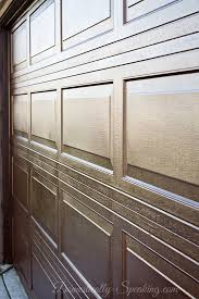 closeup on garage door makeover with stain looks like faux wood