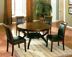 dark brown coated wooden round table four microfiber upholstered chairs dining sets set ikea dubai