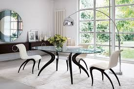 View in gallery Beautiful dining table with distinct metal and wood base  and glass top