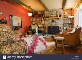 country cottage style furniture. Living Room With A Stone Fireplace Inside Country Cottage Style Residential Log Home, Quebec, Canada. This Image Is Property Furniture O