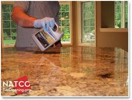 applying a sealer to granite countertop sealing