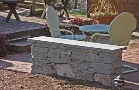 here is a small patio seat wall made of beautiful stone