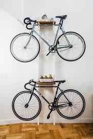 Bike hanger for apartment Space Saving Diy Bicycle Rack Built For Two Apartment Therapy Reader Project Tutorials Apartment Therapy Pinterest Diy Bicycle Rack Built For Two Apartment Therapy Reader Project