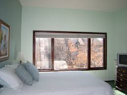 Interiorbedroomwidebrownstainedteakwoodframeglasswindow - Bedroom windows