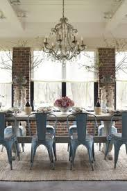 love the blue tolix chairs in this brick wall dining room create this e with the listed resources