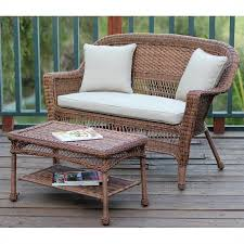 jeco wicker patio love seat and coffee table set in honey with tan cushion