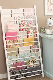 diy craft room ideas and craft room organization projects crib side repurposed into fabric storage