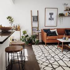 astounding brown living room chairs orange black white patterned rug brown leather couch black leg wood