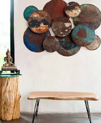 metal wall hanging buddha organic stool four faces stool on brown and teal metal wall art with metal wall art