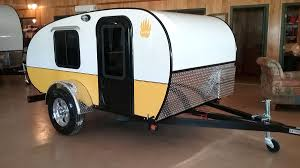 rustic trail has several teardrop models including a standy model with a tiny inside kitchen the original 900 lb papa bear teardrop comes in a base and