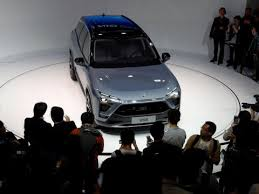 2018 tesla electric car. plain 2018 people gather at the booth of chinese electric vehicle startup nio as it  unveils throughout 2018 tesla car