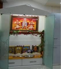 pooja room with glass door