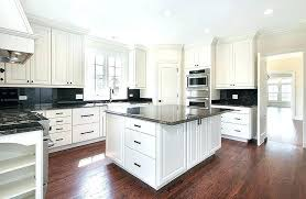 quoet kitchen with white cabinets and black countertops n9717537 black white subway tiles antique white kitchen