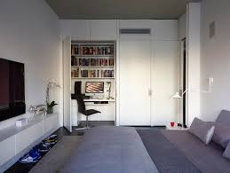 high line minimalist bedroom photo in new york with white walls and dark hardwood floors home office bedroom home office view