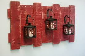 rustic wall decor diy using of the wooden planks has been unused with red painted roughing plus decorative iron wall sconces candle holders for decorate a