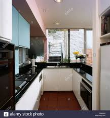 modern kitchen black and white. Modern Galley Kitchen With Black Worktops On White Fitted Units And L