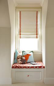 Small window seat with storage. A cozy spot to read and to store books.