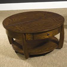 round lift top cocktail table with lower shelf and drawerhammary
