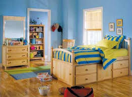 A captain's bed, named for designs used aboard ships, is a great solution  for storage in a kid's room. Manufacturer: PJ Kids.