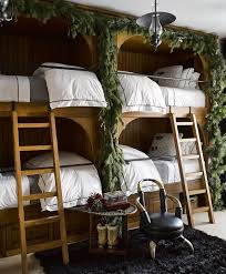 cozy wooden bunk bed with greenery cool bunk beds you wish you had as a