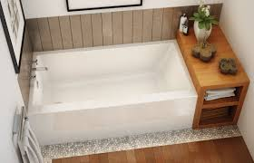 laminate floor and white bathtub home depot plus sidetable and picture on wall