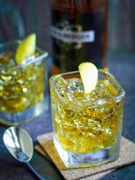 rusty nail l on ice with fresh garnish