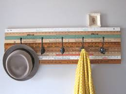 furniture assorted color rulers wall coat rack with black hooks placed on the gray wall