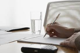 how to write the executive summary of a grant proposal businessw s hands writing on notepad in boardroom