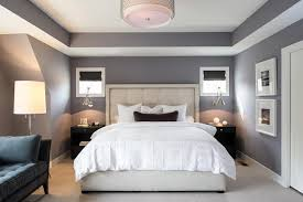The use of the wall paint color inside of the tray ceiling here really adds  some wonderful dimension and depth to the look of this bedroom.
