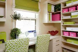 green pink and white craft and sewing room with custom built in storage from floor