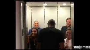 people talking in elevator. michael bisping trolls george saint pierre in the elevator. people talking elevator