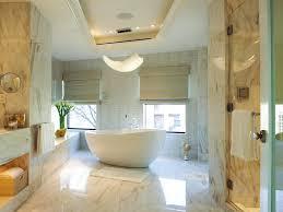 chic bathroom chandeliers crystal oval white freestanding bathtub under crystal chandeliers lamp