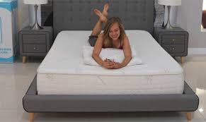 women lying on snuggle pedic mattress