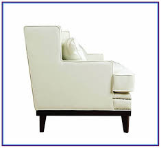 white leather chair with nailhead trim