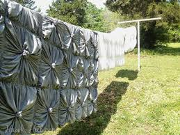 Review of Anthropologie Rosette Quilt - 5 Year Update - Hawk Hill & anthropologie rosette quilt drying on clothesline after commercial wash Adamdwight.com